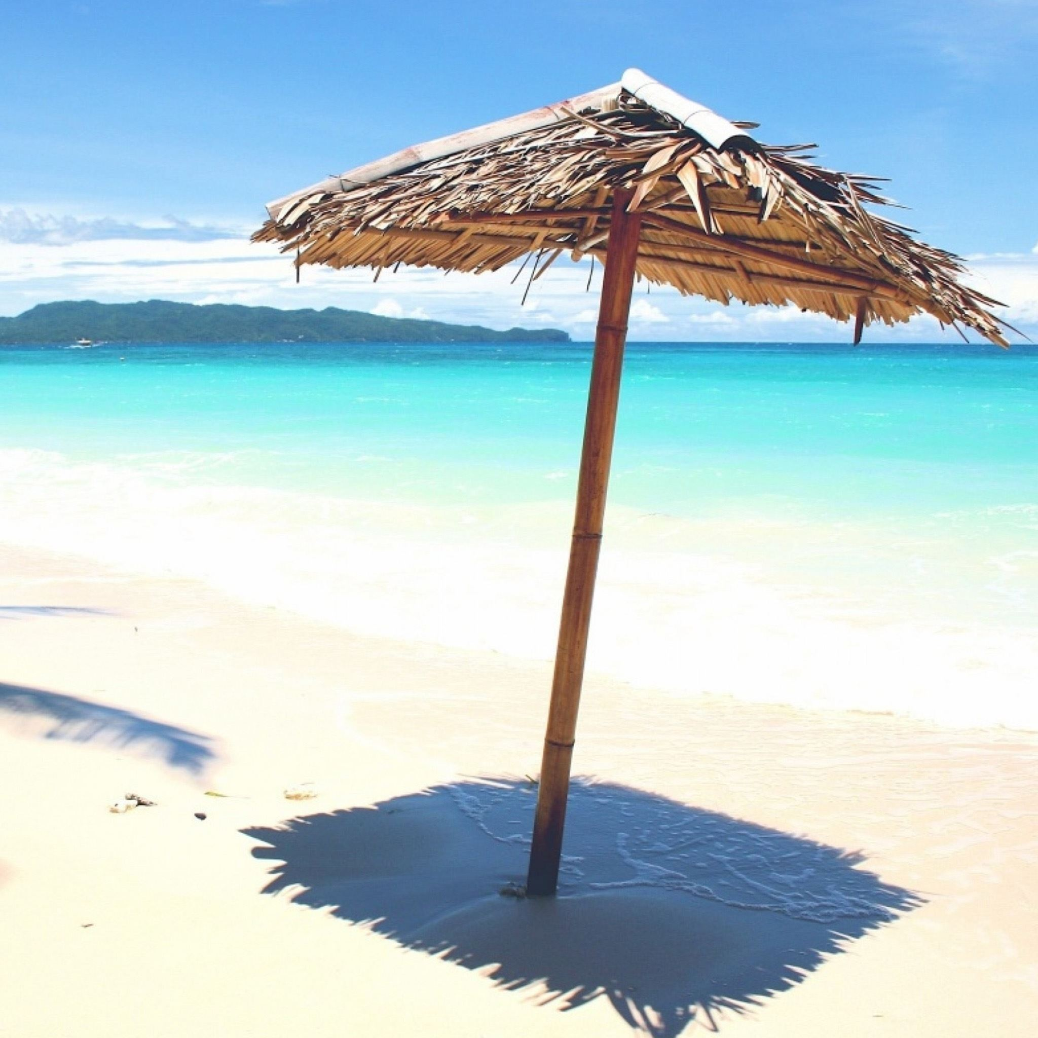 Sandy Beach Umbrella iPad Air wallpaper