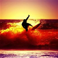 Surfing Under Ocean Sunset iPad wallpaper