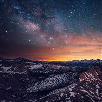 Shiny Sky View Over Snowy Mountains iPad Air wallpaper