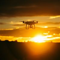 Quadrocopter Sunset Sky Flight Drone iPad Air wallpaper