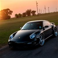 Porsche 911 Turbo 997 Black Front Sun Grass Reflections iPad Air wallpaper