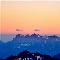 Mountains Fog Sunset Sky iPad wallpaper