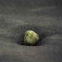 Stone In black sand iPad wallpaper
