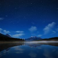 Night lake stars water smooth surface fog iPad wallpaper