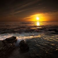 Sun decline evening stones waves orange landscape iPad Pro wallpaper