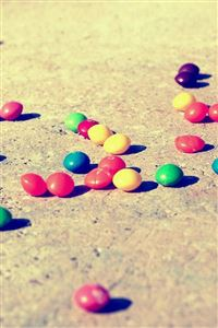 Colorful Candies On The Ground iPhone wallpaper