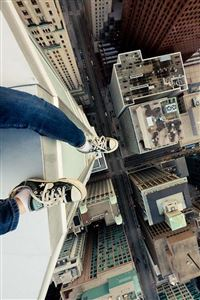 Hanging Above New York Feet In Air iPhone 4s wallpaper