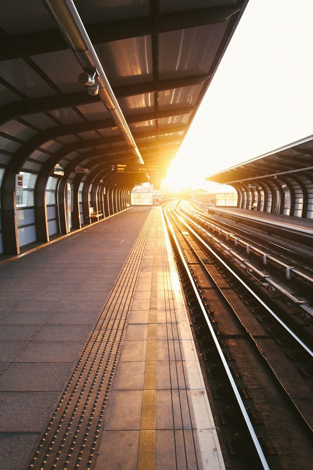 Train station sun iPhone 4s wallpaper