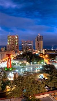 Building sky night city lights iPhone 8 wallpaper