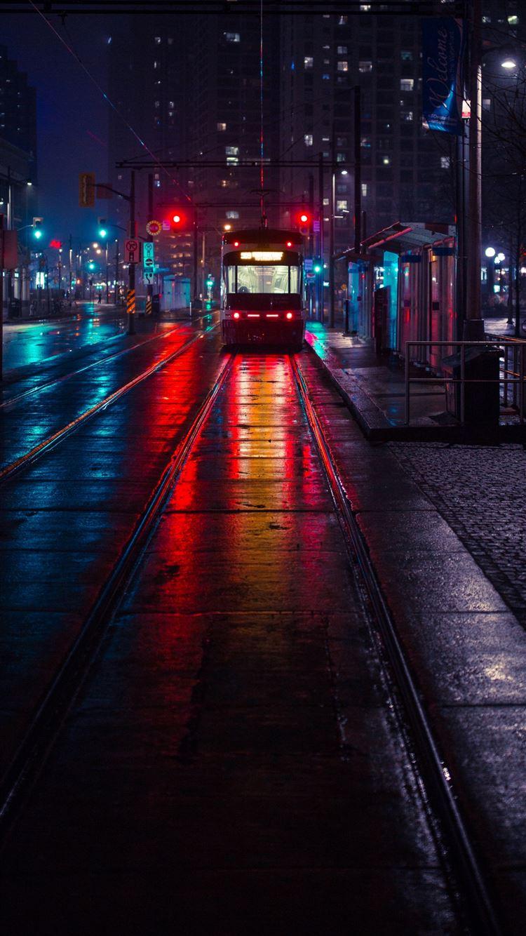 Trolley stop city evening lighting iPhone 8 wallpaper