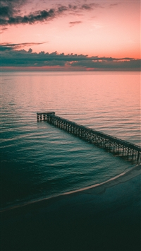 Pier dock sea dusk shore iPhone 8 wallpaper