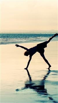 Sea shore silhouette water jump iPhone wallpaper