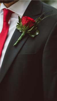 Groom-wearing-a-red-flower iPhone 8 wallpaper