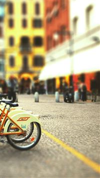 Cityscapes Streets Bicycles Blur iPhone se wallpaper