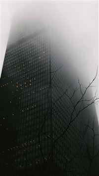 Skyscraper Covered In Fog iPhone se wallpaper