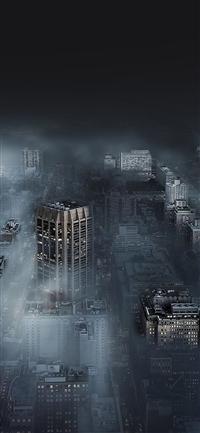 Dark city in fog iPhone X wallpaper