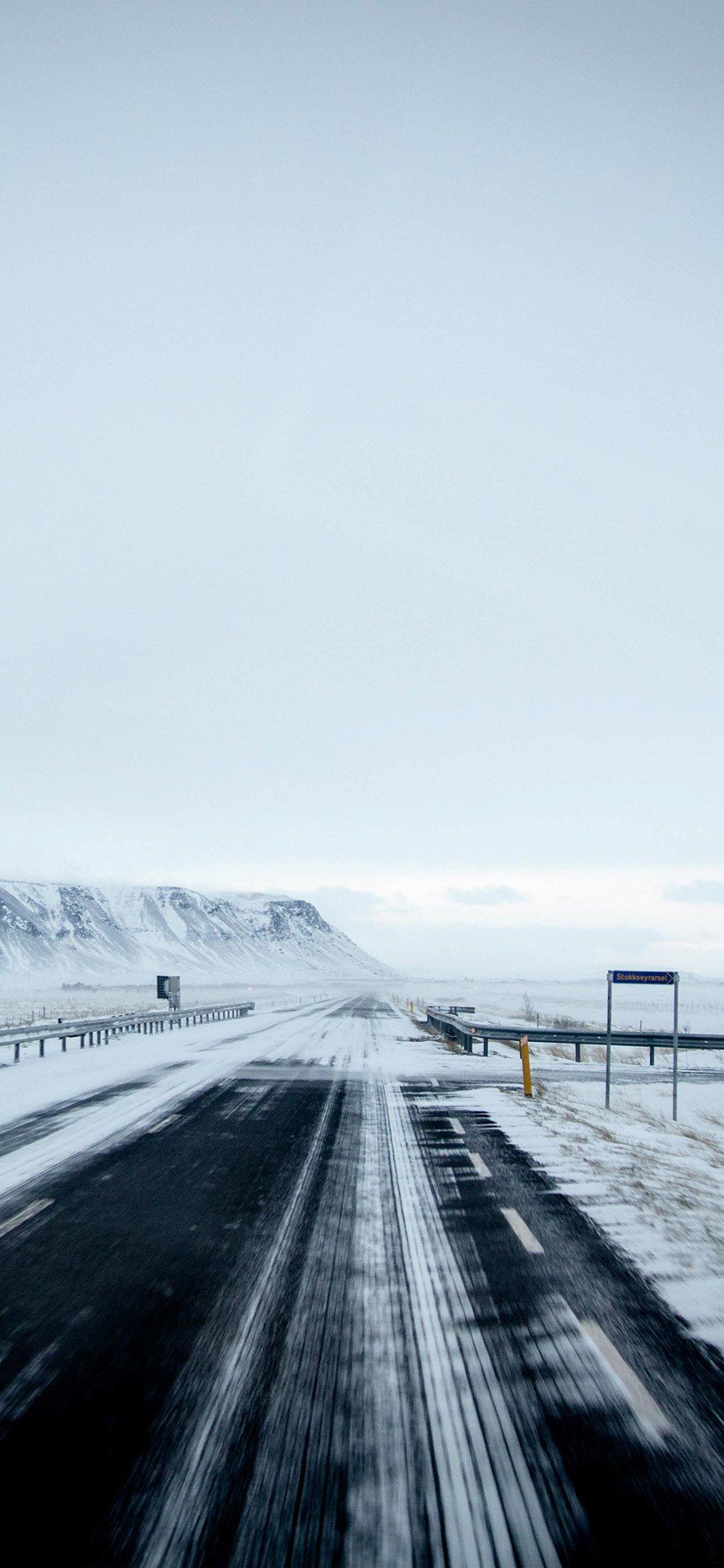 Winter road mountain iPhone X wallpaper