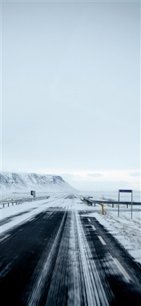 Winter road mountain iPhone X wallpaper