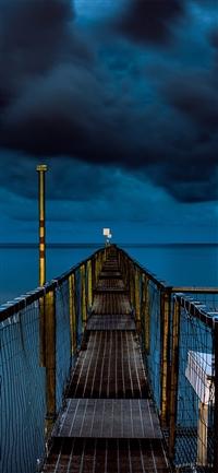 sea night blue dark bridge iPhone X wallpaper