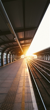 Train station charles city sun iPhone X wallpaper