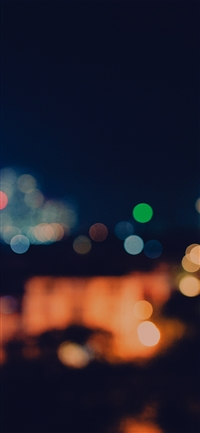 Bokeh city night light iPhone X wallpaper