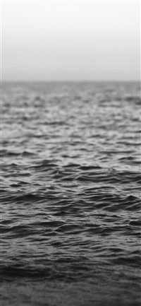 Ocean wave bokeh iPhone X wallpaper
