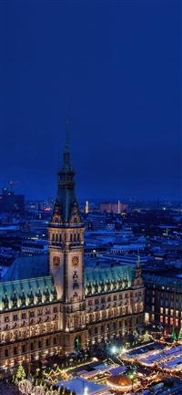 Blue night winter city iPhone X wallpaper
