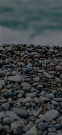 Beach stones sea iPhone X wallpaper