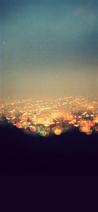 Bokeh night city view lights iPhone X wallpaper