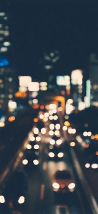 City bokeh night street iPhone X wallpaper