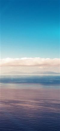 Blue sky ocean view flare iPhone X wallpaper