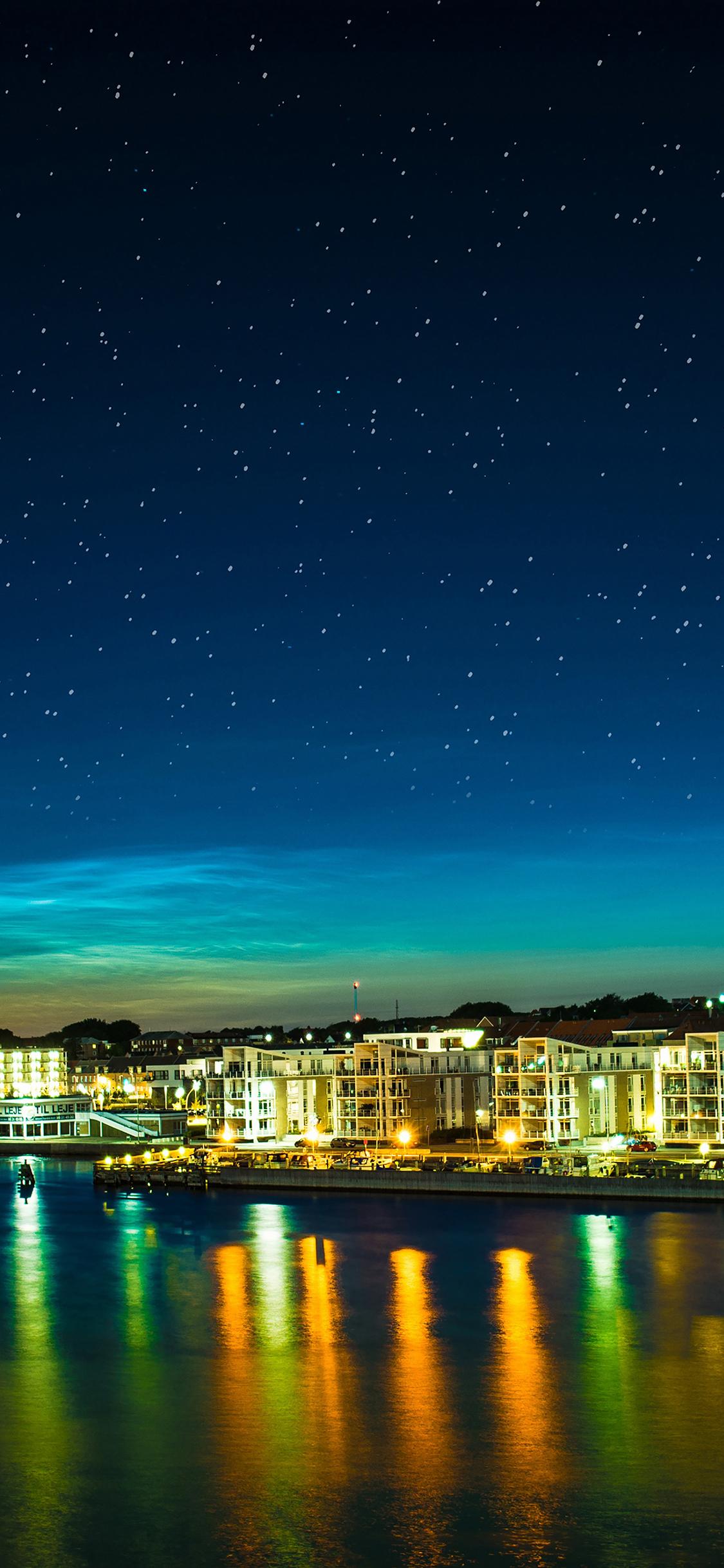 Night scene from sea cityscape iPhone X wallpaper