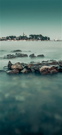 Foggy island sea iPhone X wallpaper
