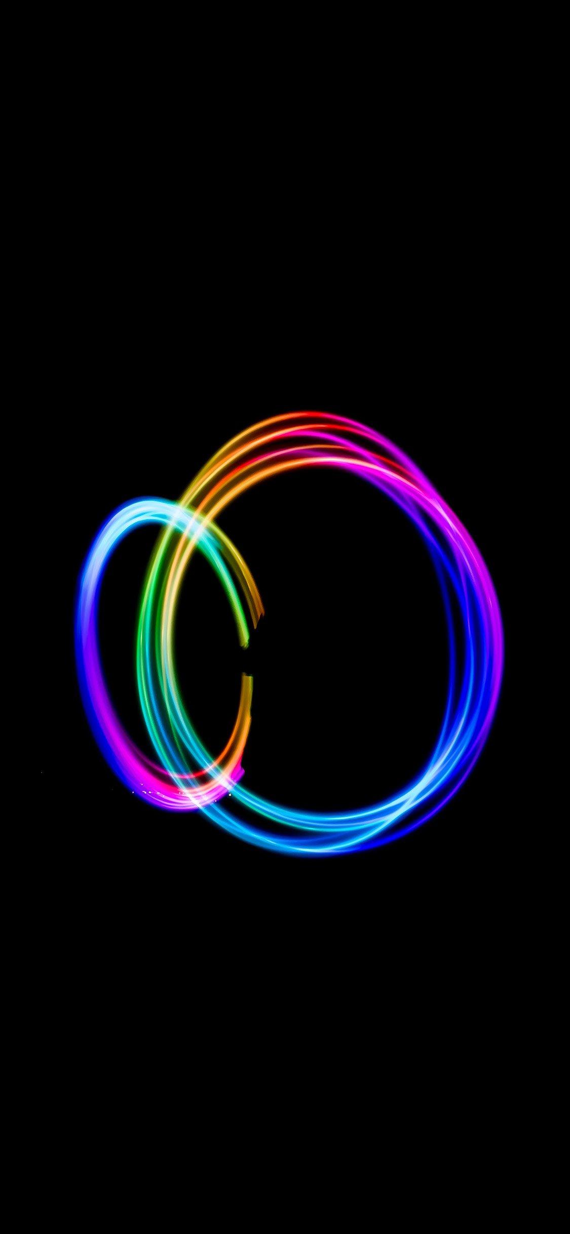 Dark circle rainbow art iPhone X wallpaper