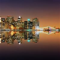 Lively Night Cityscape River Bank iPad wallpaper