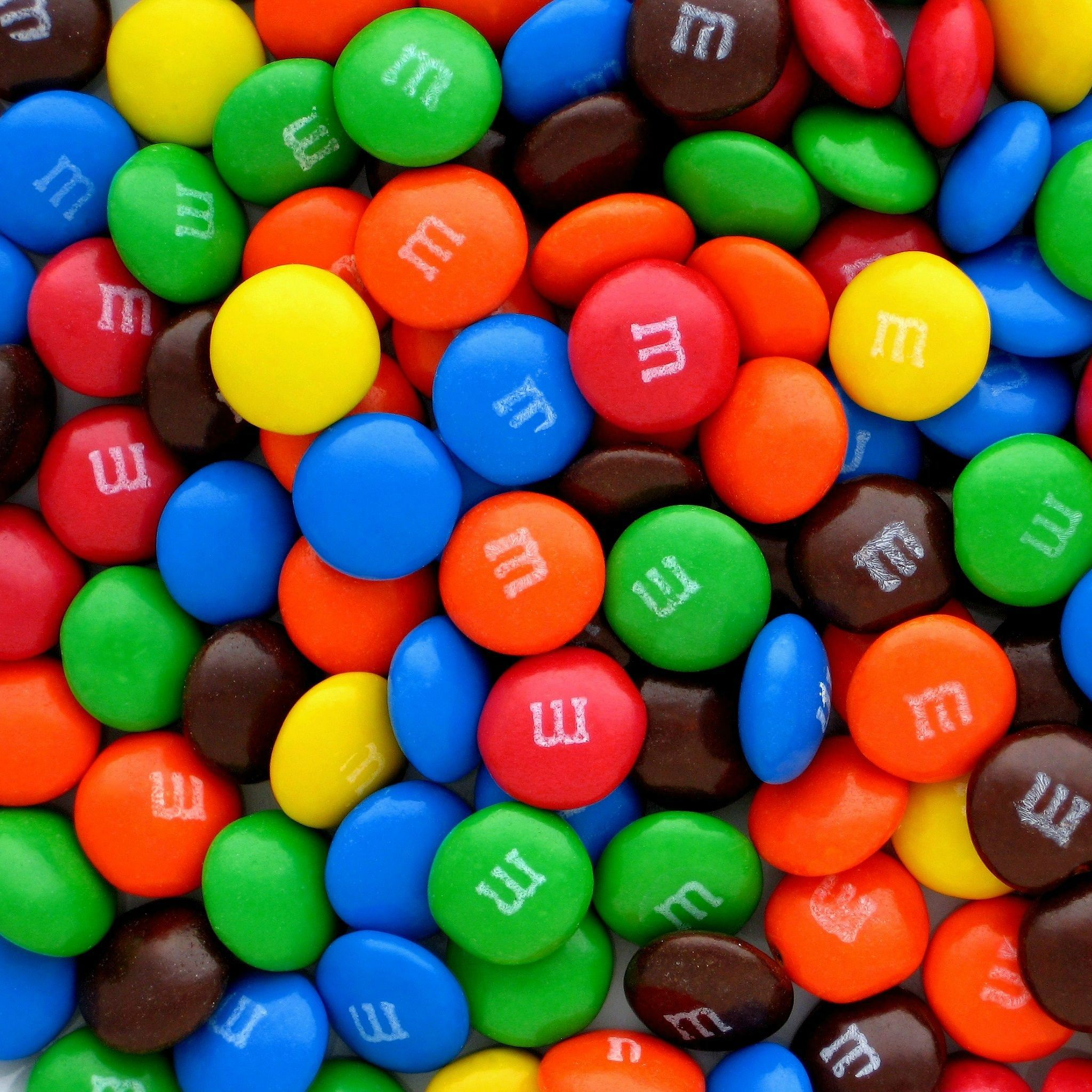 Colorful M&Ms Candy Pills Overlap iPad Air wallpaper
