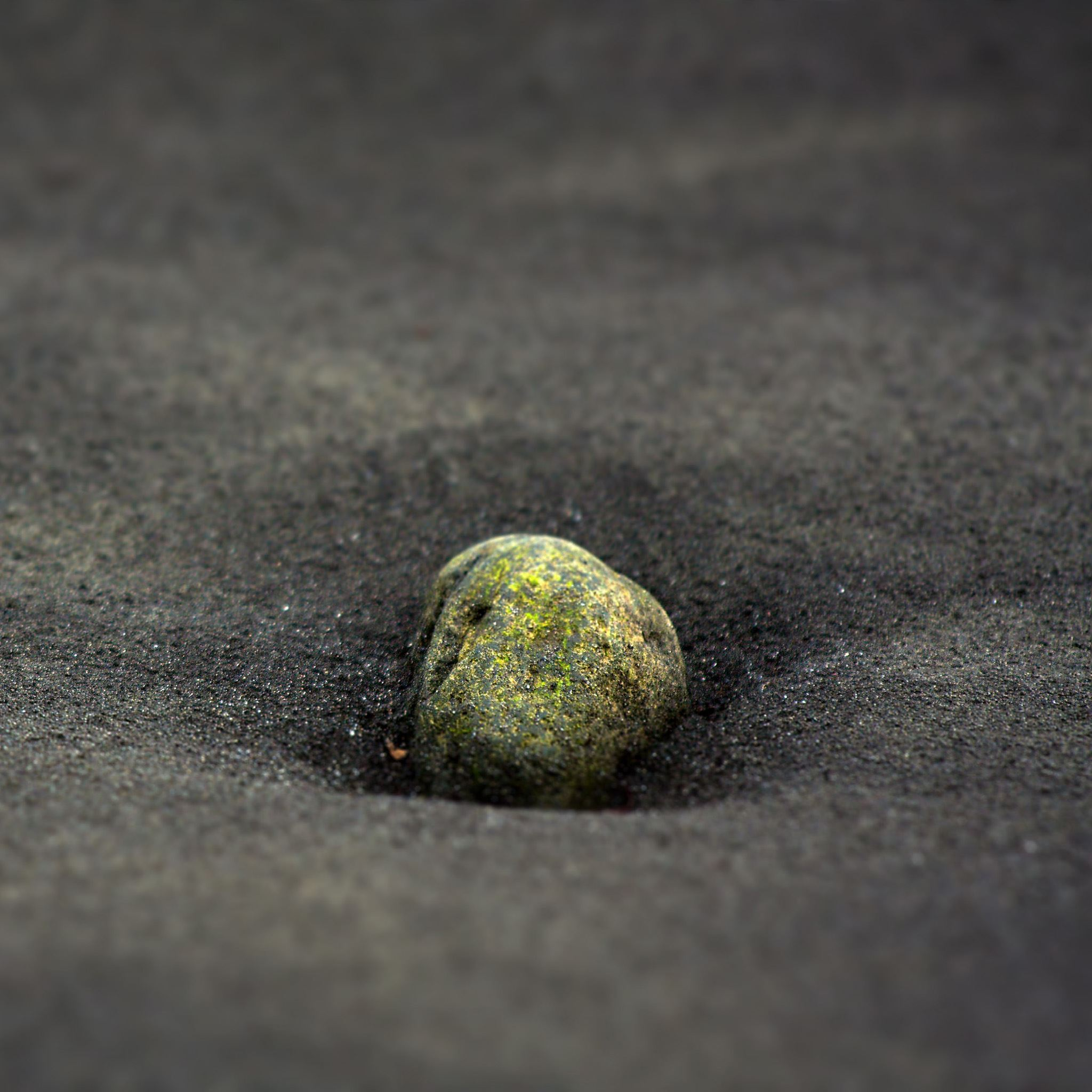 Stone In black sand iPad Air wallpaper
