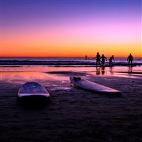 Surfers beach sunset iPad Air wallpaper