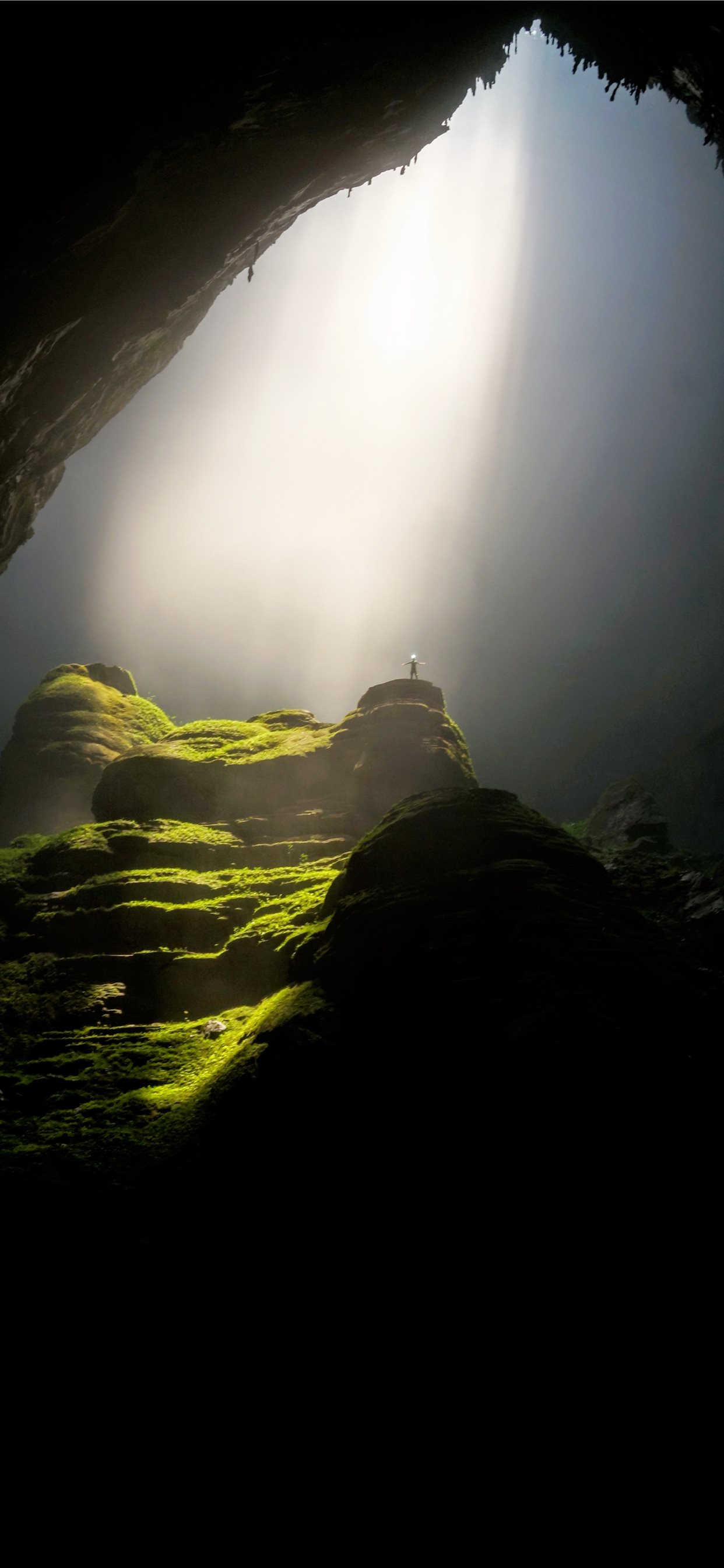 Person On Top Of Rock Formation Inside Cave Iphone X Wallpapers Free Download