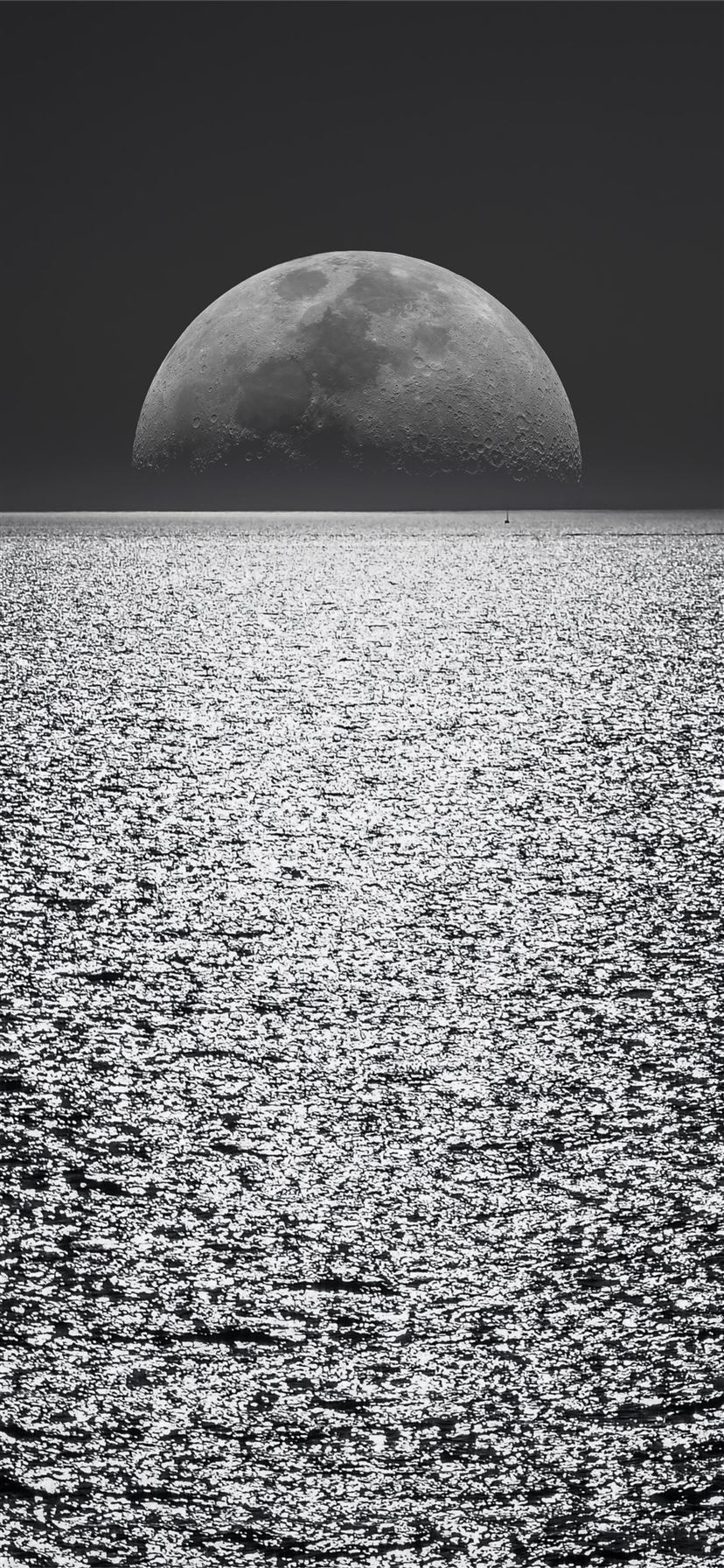 black and white moon ocean during night time iPhone 11 wallpaper