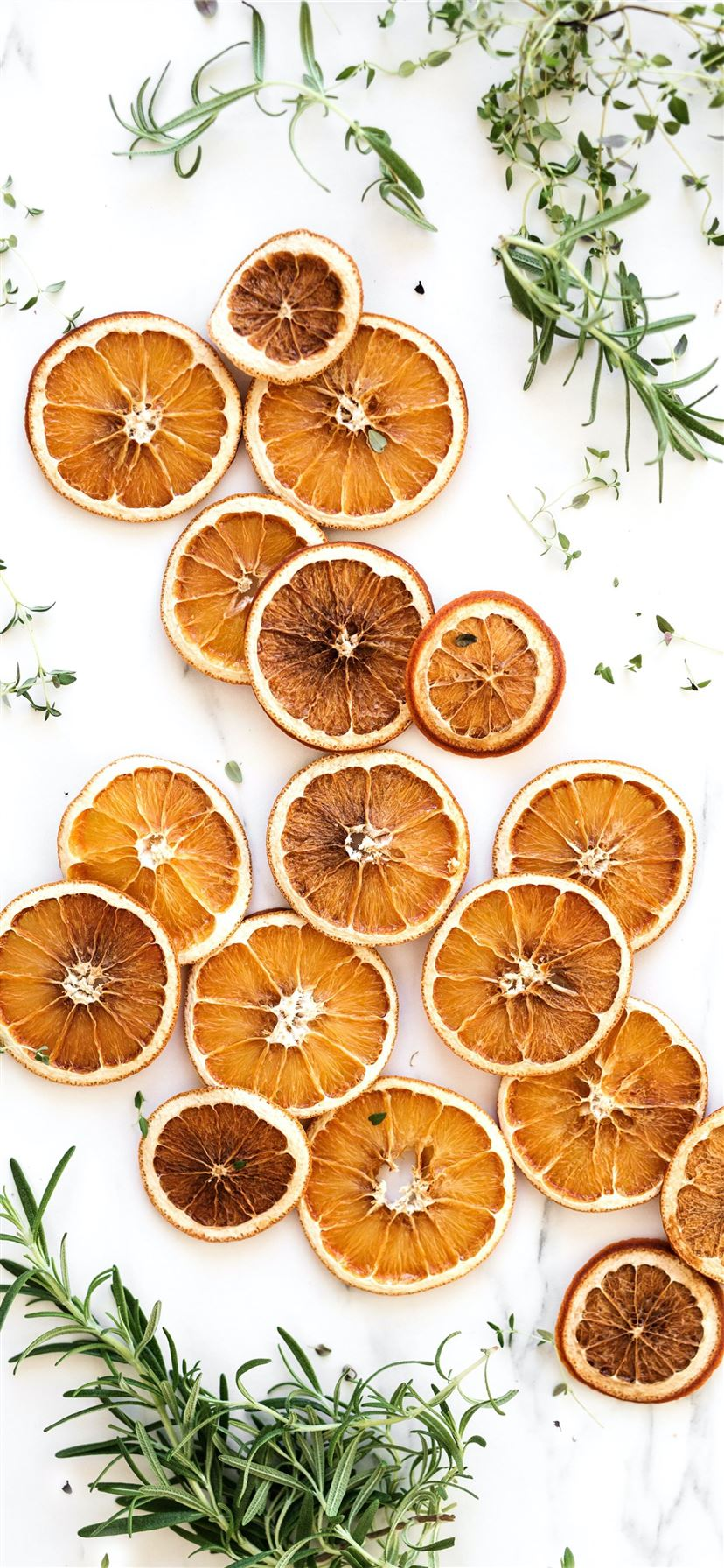 sliced lemons surrounded by green herbs iPhone 11 wallpaper