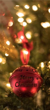 red Christmas bell on Christmas tree iPhone 11 wallpaper