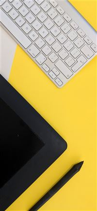 gray Apple wireless keyboard beside black tablet c... iPhone 11 wallpaper