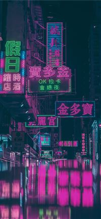 assorted neon light signage on street during night... iPhone 11 wallpaper