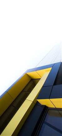 black and yellow building under white clouds iPhone 11 wallpaper