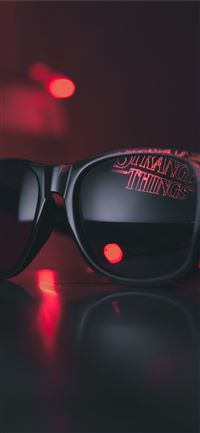 black wayfarer sunglasses on black surface iPhone 11 wallpaper