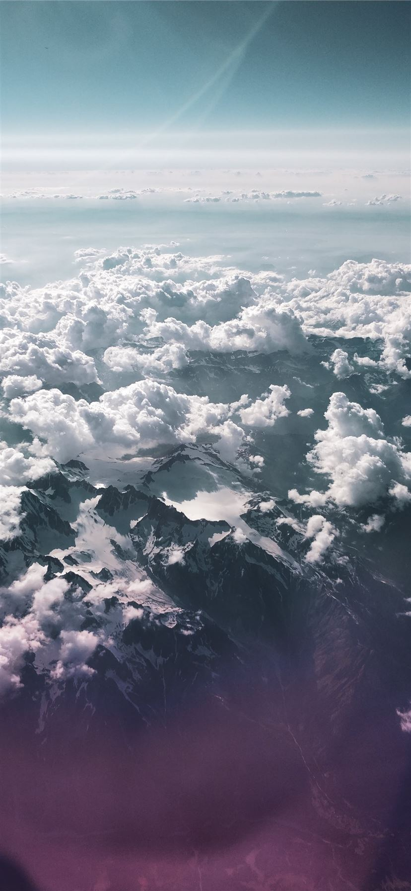 mountain under sea of clouds iPhone 11 wallpaper