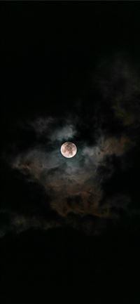 moon covered with clouds at nighttime iPhone 11 wallpaper