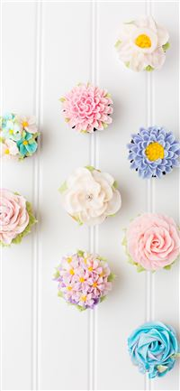 flower cupcakes on white surface iPhone 11 wallpaper