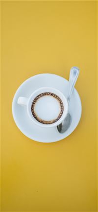 filled white teacup on saucer with teaspoon iPhone 11 wallpaper